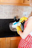 Close-up of a caucasian woman doing the dishes — Stock Photo