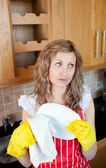 Attractive young woman drying dishes — Stock Photo