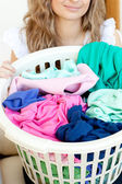 Close-up of a young woman doing laundry — Stock Photo