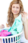 Upset woman doing laundry — Stock Photo