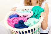 Close-up of a caucasian woman doing laundry — Stock Photo