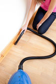 Close-up of a woman vacuuming — Stock Photo