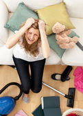 Stressed young woman doing housework — Stock Photo