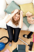 Frustrated young woman doing housework — Stock Photo