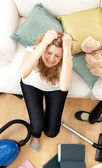 Depressed young woman doing housework — Stock Photo
