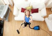 High angle of a cheerful woman vacuuming — Stock Photo