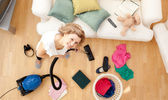 Smiling blond woman vacuuming the living-room — Stock Photo