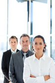 Matureusinessman in a line with his business team — Stock Photo