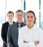 Businessman in a row with his business team — Stock Photo