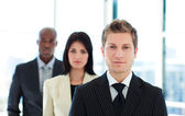 Junior businessman leading his team — Stock Photo