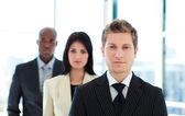 Junior businessman leading his team — Stock Photo