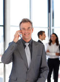 Smiling mature businessman on phone — Stock Photo