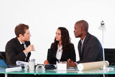 Three business discussing in a meeting — Stock Photo