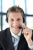 Businessman talking on a headset — Stock Photo