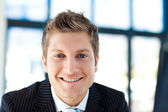 Attractive businessman smiling at the camera — Stock Photo