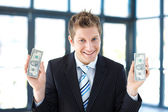 Young businessman holding money — Stock Photo