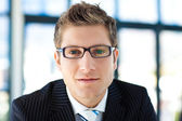 Businessman looking to the camera wearing glasses — Stock Photo