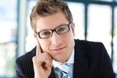 Junior businessman looking to the camera wearing glasses — Stock Photo