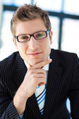 Handsome businessman wearing glasses — Stock Photo