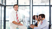 Mature manager in a call center — Stock Photo