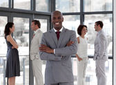 Afro-american male leader with his team — Stock Photo