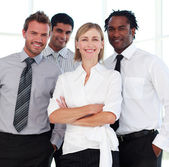 Business team smiling at the camera — Stock Photo