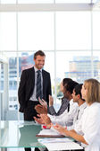 Happy businessman after giving a presentation with success — Stock Photo