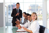 Happy manager clapping in a presentation — Stock Photo