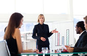 Businesswoman interacting to her colleagues — Stock Photo