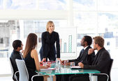 Businesswoman interacting to her team — Stock Photo