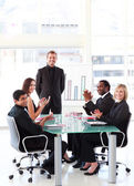 Business applauding a colleague in a presentation — Stock Photo