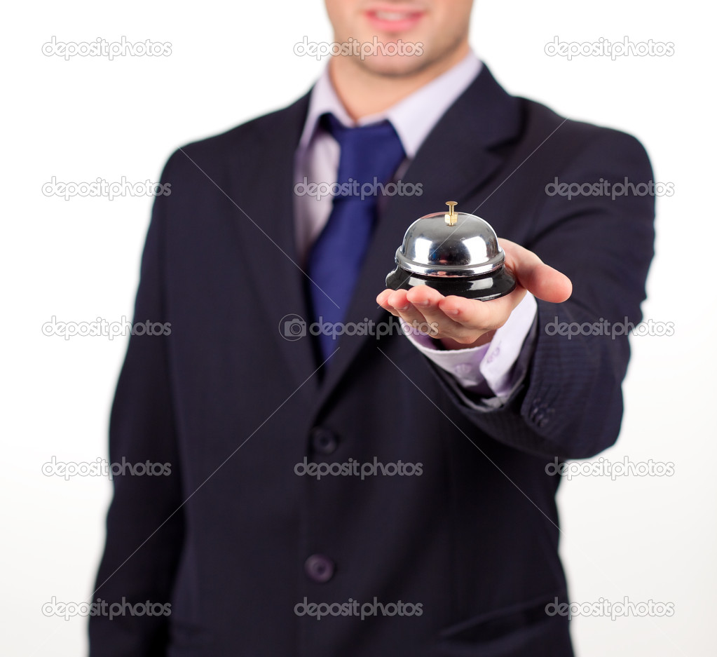 Young attractive waiter holding a hotel bell — Stock Photo #10301310