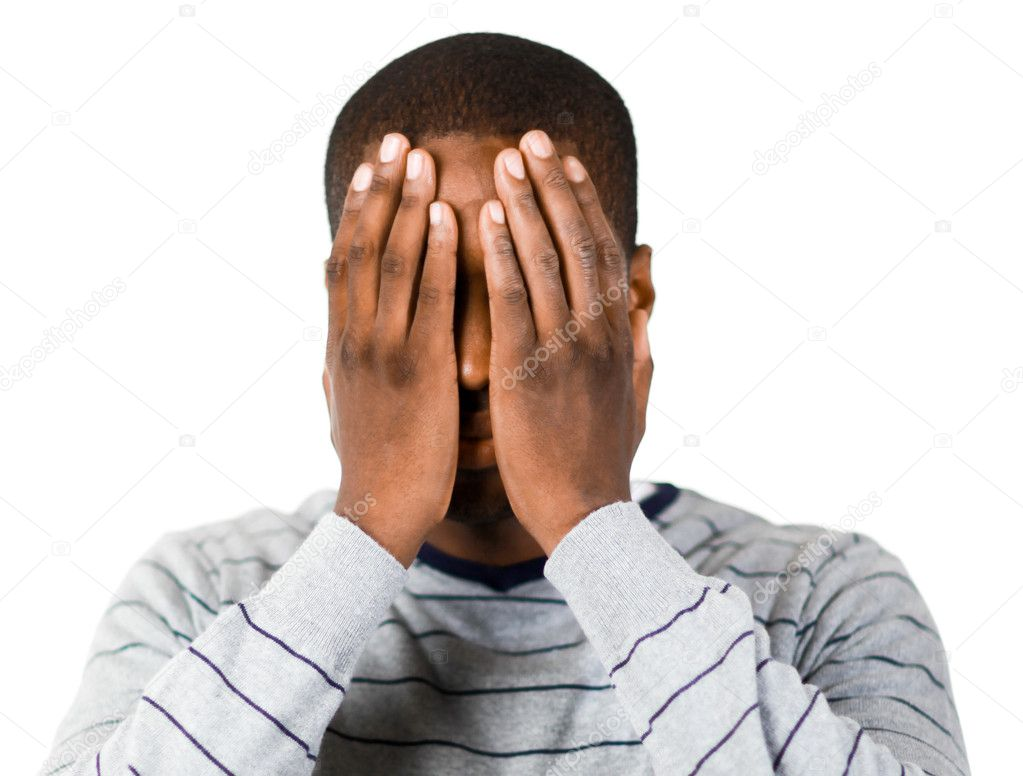 Young man covering his face in despair — Stock Photo #10302226