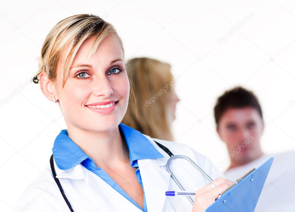 Portrait of a blonde doctor with a patient in the background — Stock Photo #10302290