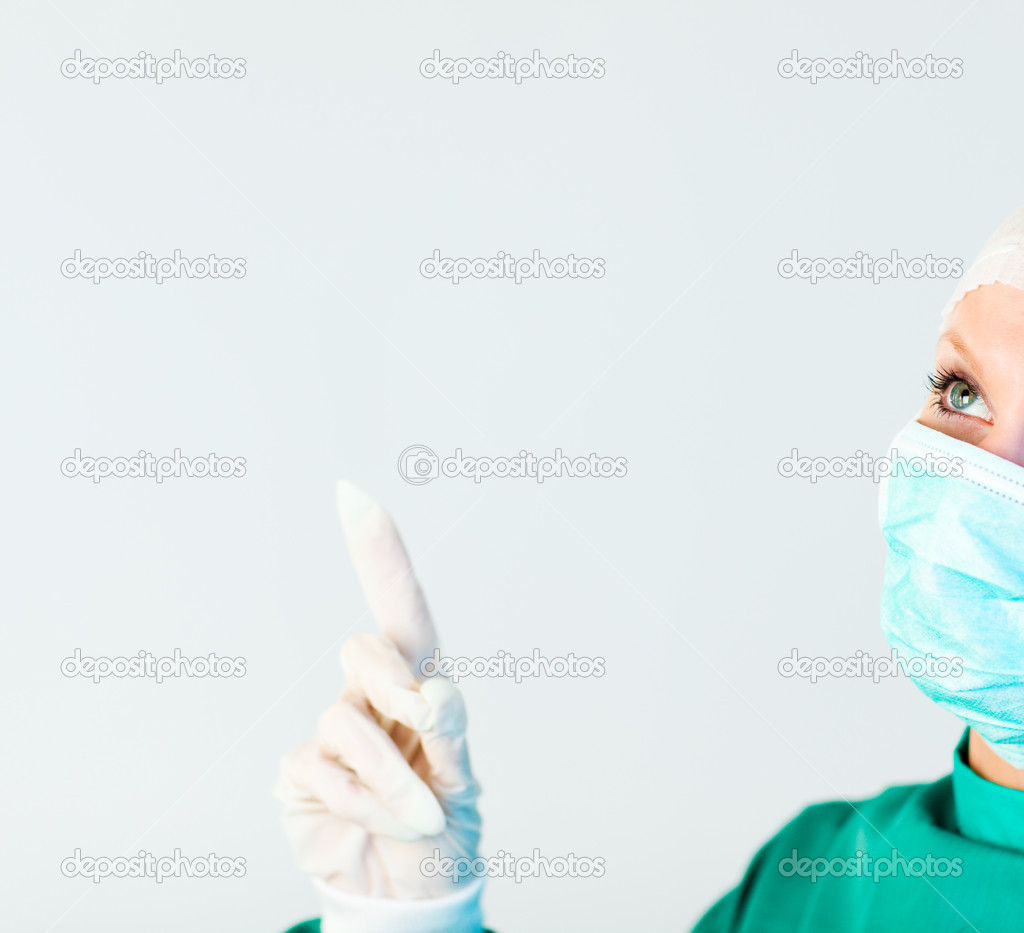 Young female surgeon looking upwards — Stock Photo #10303338