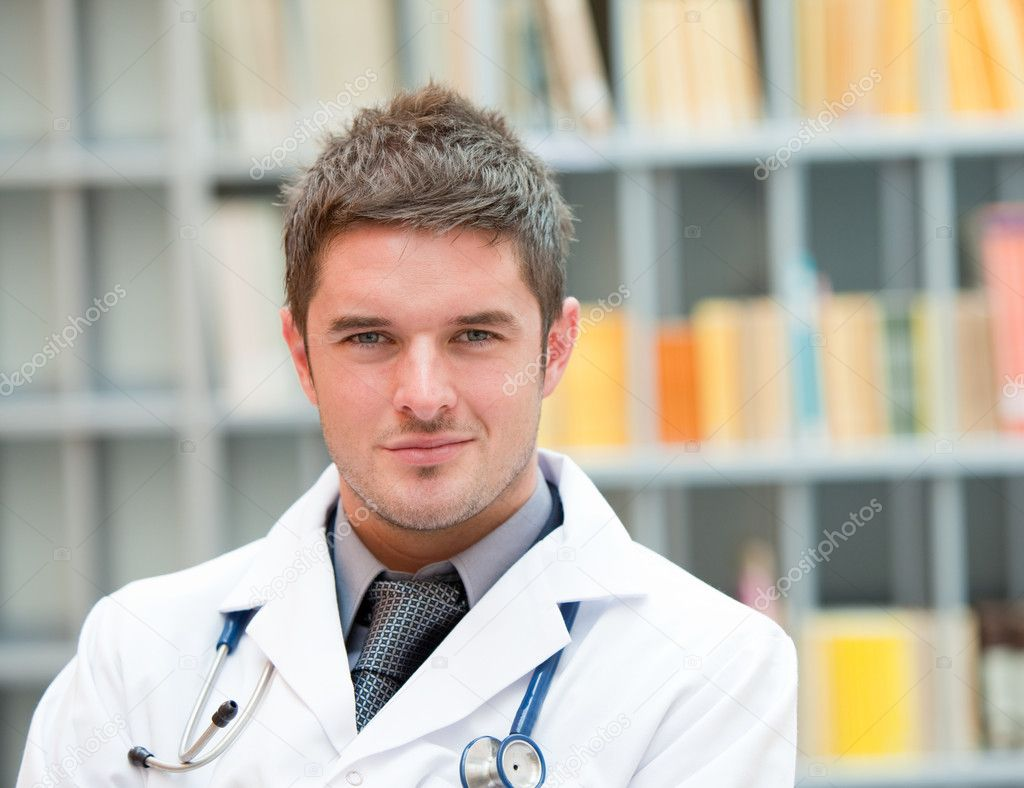 Young doctor at work in hospital — Stock Photo #10303415
