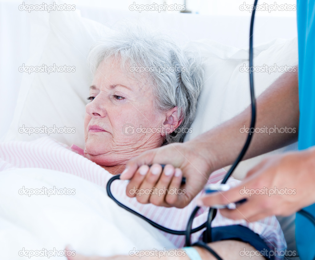 Sick Senior Woman Lying On A Hospital Bed