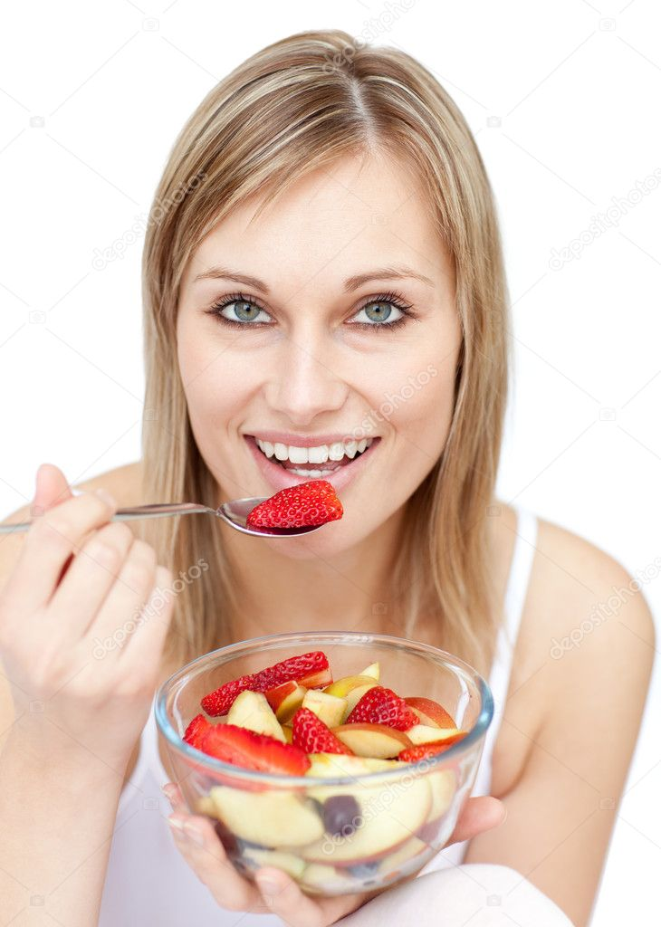 Young woman eating a fruit salad against a white background — Stock Photo #10305623