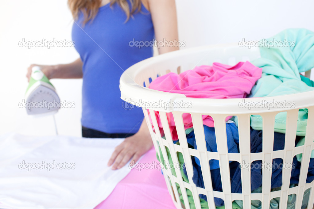 Close-up of a woman ironing against a white background  Stock Photo #10305842