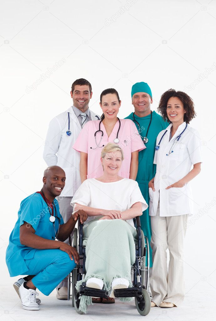 Group of doctors with a patient in a wheel chair — Stock Photo #10307698