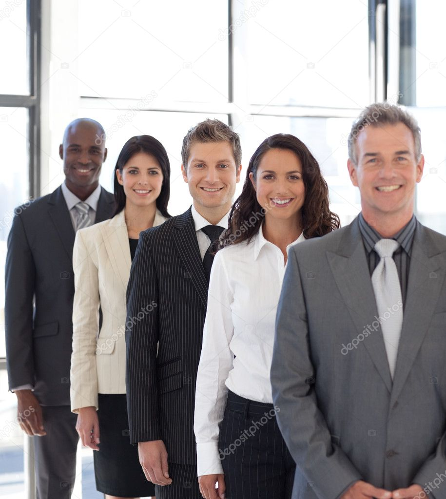 Business team from different cultures looking at camera — Stock Photo #10308948