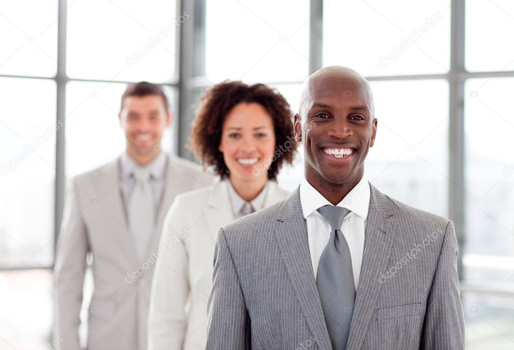 African young businessman smiling at the camera — Stock Photo #10308973