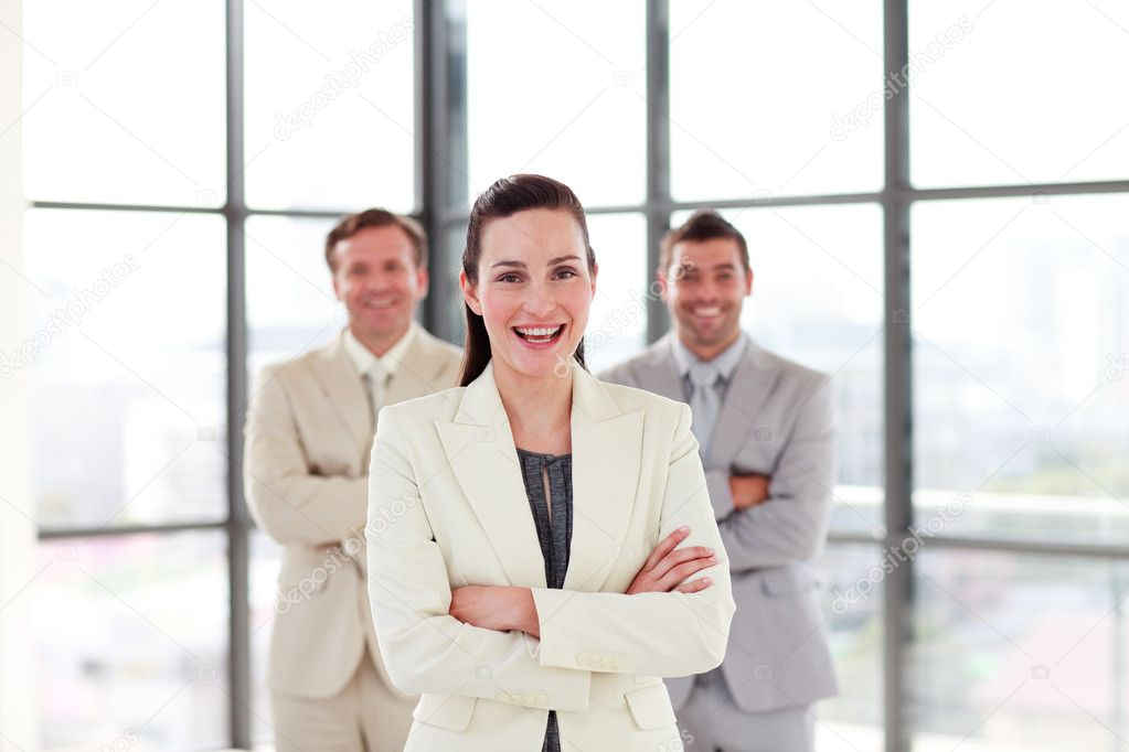 Attractive businesswoman with folded arms in office — Stock Photo #10308982
