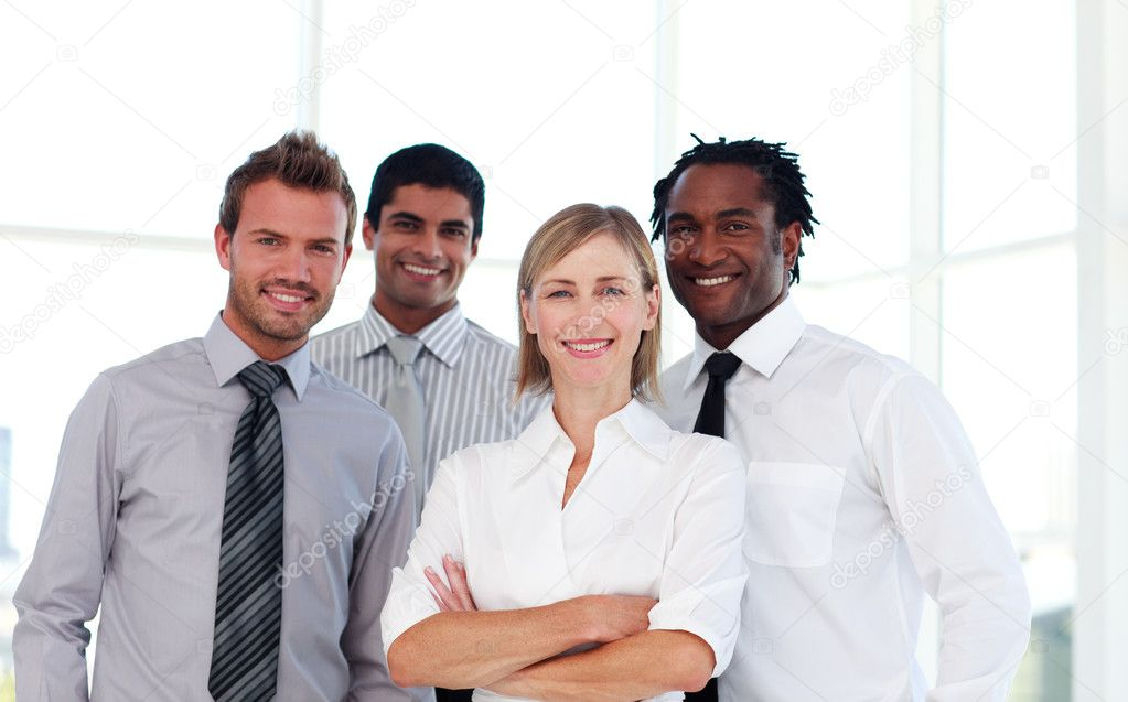 International confident business team smiling at the camera — Stock Photo #10309271