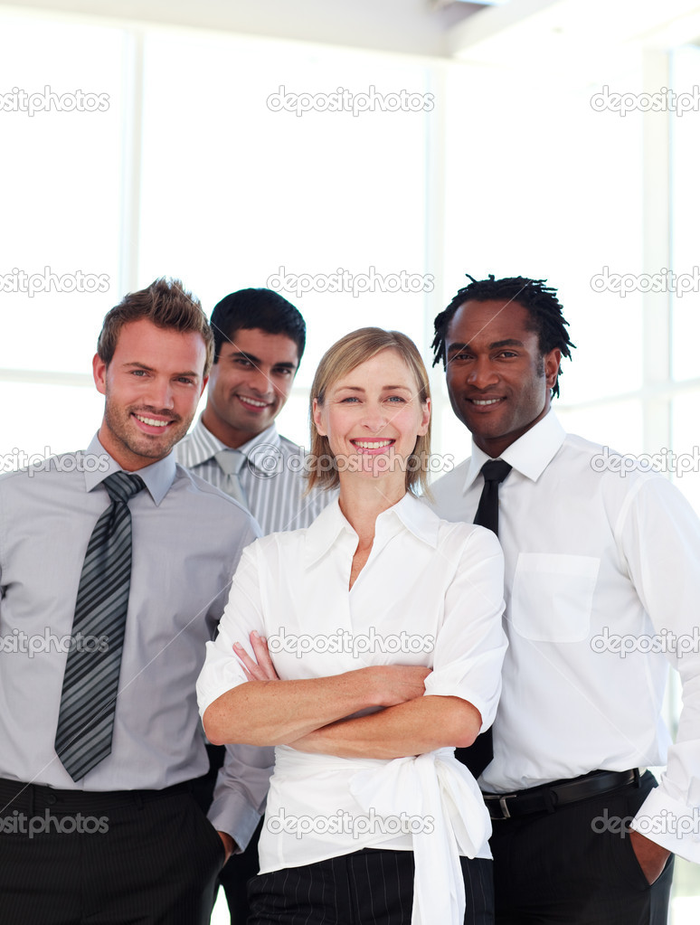 International business team smiling at the camera — Stock Photo #10309280