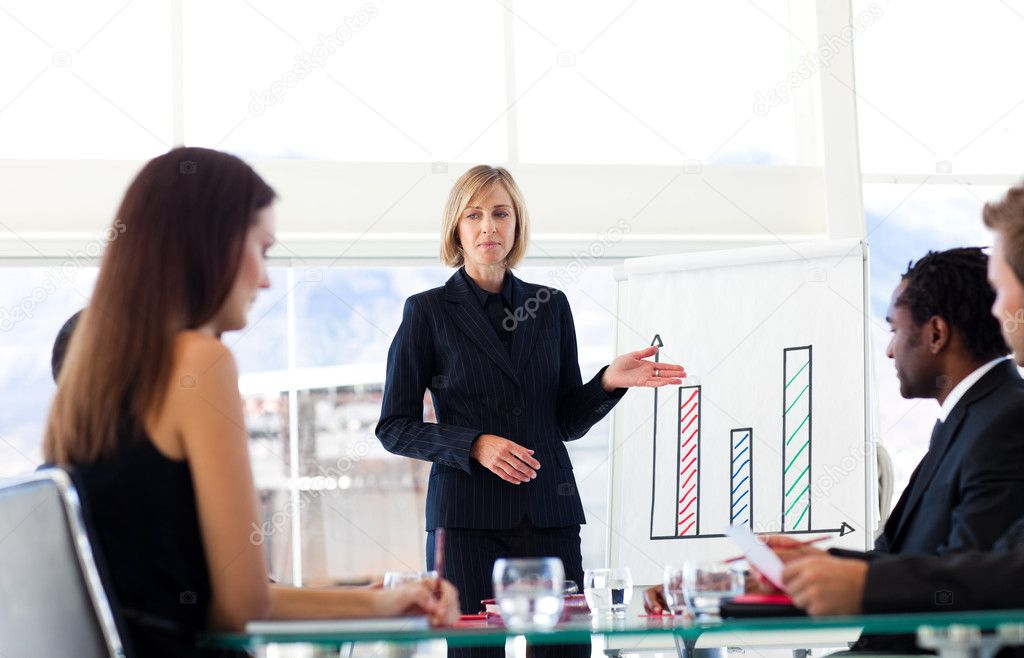 Businesswoman interacting to her colleagues in a meeting  Stock Photo #10309519