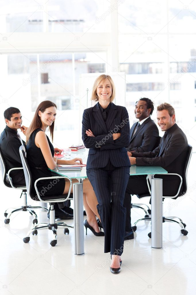 Multi-ethnic business team smiling at the camera in a meeting  Stock Photo #10309532