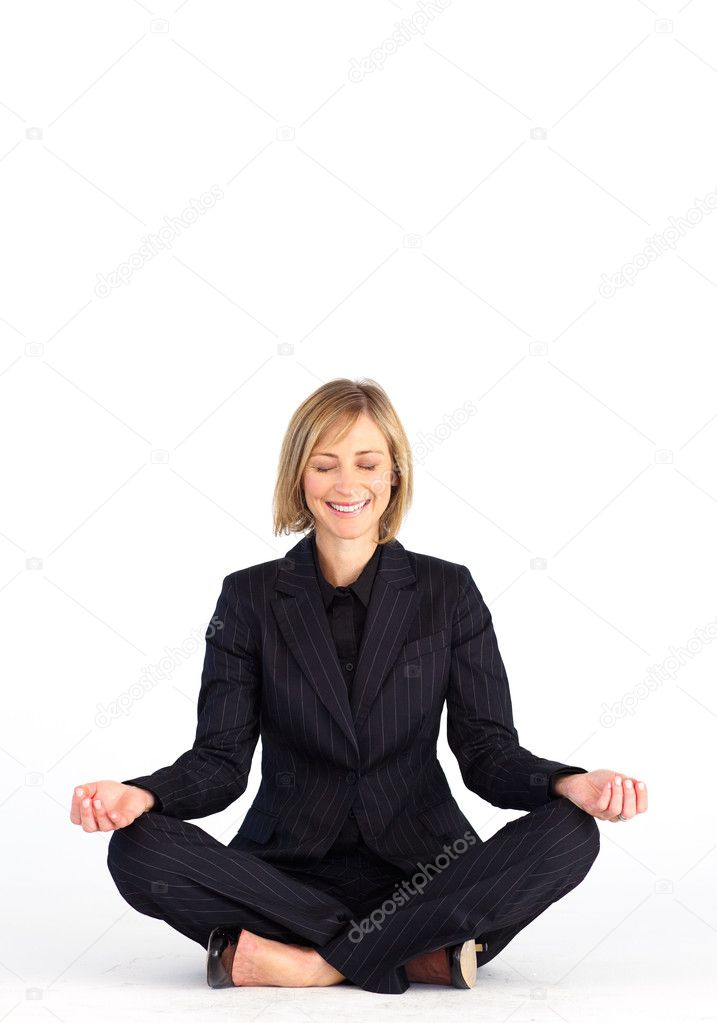 Mature businesswoman doing meditation exercises on the floor — Stock Photo #10309634
