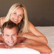 Charming couple enjoying together in bed — Stock Photo