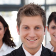 Stock Photo: Smiling business manager leading his team